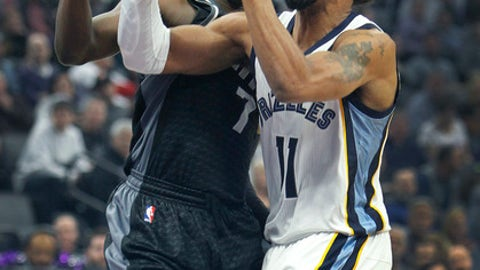 Memphis Grizzlies guard Mike Conley (11) drives to the basket against Sacramento Kings defender Darren Collison (7) during the first half of an NBA basketball game in Sacramento, Calif., Saturday, Dec. 31, 2016. (AP Photo/Steve Yeater)