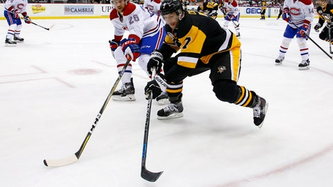 Pittsburgh Penguins' Matt Cullen (7) skates into the corner with the puck with Montreal Canadiens' Jeff Petry (26) defending during the second period of an NHL hockey game in Pittsburgh, Saturday, Dec. 31, 2016. (AP Photo/Gene J. Puskar)