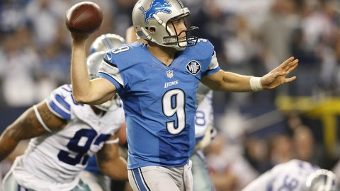 Jan 4, 2015; Arlington, TX, USA; Detroit Lions quarterback Matthew Stafford (9) throws the ball in the fourth quarter against the Dallas Cowboys in the NFC Wild Card Playoff Game at AT&T Stadium. Mandatory Credit: Kevin Jairaj-USA TODAY Sports