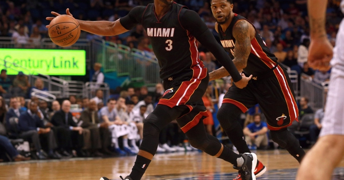 9237580-dwyane-wade-victor-oladipo-nba-miami-heat-orlando-magic.vresize.1200.630.high.0