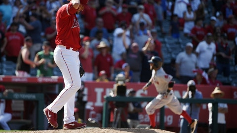 Jul 31, 2016; Anaheim, CA, USA; Los Angeles Angels pitcher Huston Street (left) reacts after allowing a three-run home run to Boston Red Sox second baseman Dustin Pedroia (right) during the ninth inning at Angel Stadium of Anaheim. Mandatory Credit: Kelvin Kuo-USA TODAY Sports