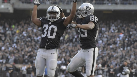 Dec 4, 2016; Oakland, CA, USA; Oakland Raiders wide receiver Amari Cooper (89) and running back Jalen Richard (30) celebrate after a  37-yard touchdown reception by Cooper in the fourth quarter against the Buffalo Bills during a NFL football game at Oakland Coliseum. The Raiders defeated the Bills 38-24. Mandatory Credit: Kirby Lee-USA TODAY Sports