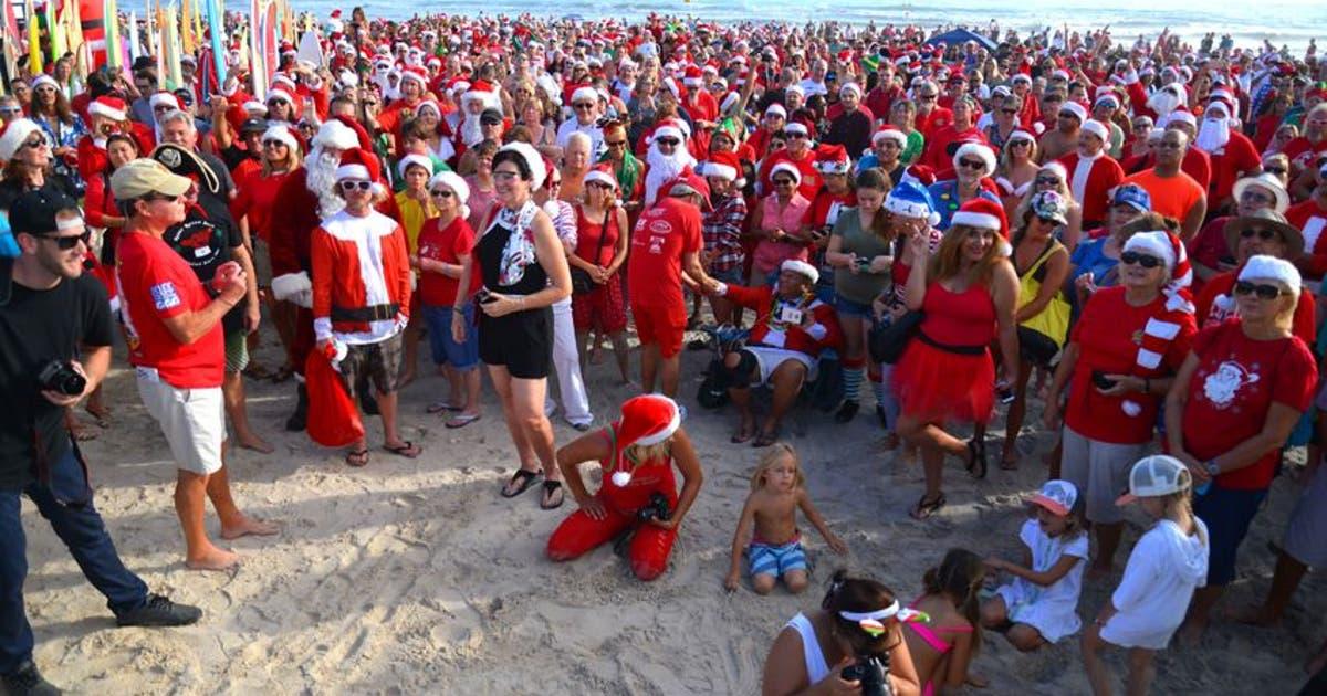 9766703-news-surfing-santa-2016.vresize.1200.630.high.0