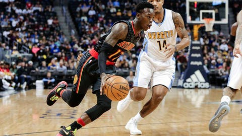 Dec 23, 2016; Denver, CO, USA; Denver Nuggets guard Gary Harris (14) guards Atlanta Hawks guard Dennis Schroder (17) in the first quarter at the Pepsi Center. Mandatory Credit: Isaiah J. Downing-USA TODAY Sports