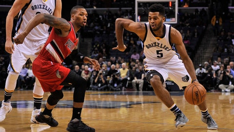 Dec 8, 2016; Memphis, TN, USA; Memphis Grizzlies guard Andrew Harrison (5) drives to the basket against Portland Trail Blazers guard Damian Lillard (0) during the first half  at FedExForum. Mandatory Credit: Justin Ford-USA TODAY Sports