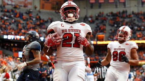 Nov 12, 2016; Syracuse, NY, USA; (Editors note: Caption correction) North Carolina State Wolfpack running back Matthew Dayes (21) runs into the end zone for a touchdown against the Syracuse Orange during the third quarter at the Carrier Dome. North Carolina State defeated Syracuse 35-20. Mandatory Credit: Rich Barnes-USA TODAY Sports