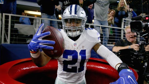 ARLINGTON, TX - DECEMBER 18:  Ezekiel Elliott #21 of the Dallas Cowboys celebrates after scoring a touchdown by jumping into a Salvation Army red kettle during the second quarter against the Tampa Bay Buccaneers at AT&T Stadium on December 18, 2016 in Arlington, Texas.  (Photo by Tom Pennington/Getty Images)