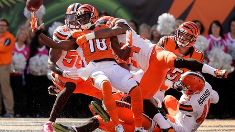 Somehow, A.J. Green reeled in this Hail Mary touchdown with Browns draped over him