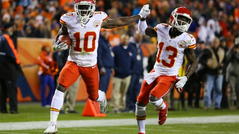 Breakout rookie Tyreek Hill high-fives De'Anthony Thomas during a punt return score