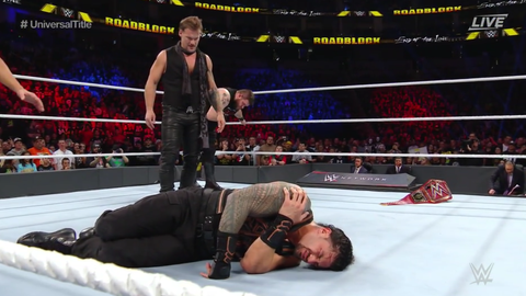 Kevin Owens defeated Roman Reigns by disqualification after Chris Jericho interfered