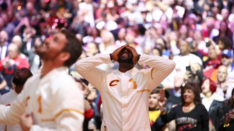 LeBron James gets emotional watching highlights from his championship run before receiving his ring on opening night