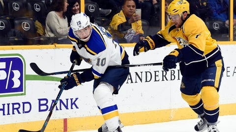 St. Louis Blues right wing Scottie Upshall (10) controls the puck as he is defended by Nashville Predators defenseman Yannick Weber (7), of Switzerland, during the first period of an NHL hockey game, Tuesday, Dec. 13, 2016, in Nashville, Tenn. (AP Photo/Mark Zaleski)