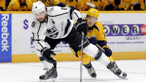 Los Angeles Kings defenseman Drew Doughty (8) is followed by Nashville Predators left wing Viktor Arvidsson (38), of Sweden, during the first period of an NHL hockey game Thursday, Dec. 22, 2016, in Nashville, Tenn. (AP Photo/Mark Humphrey)