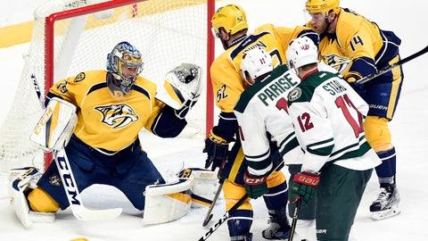 Nashville Predators goalie Pekka Rinne (35), of Finland, gloves a shot against the Minnesota Wild during the third period of an NHL hockey game Tuesday, Dec. 27, 2016, in Nashville, Tenn. The Wild won in overtime 3-2. (AP Photo/Mark Zaleski)