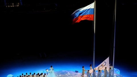 SOCHI, RUSSIA - FEBRUARY 07:  Chulpan Khamatova, Lidiya Skoblikova, Anastasia Popova, Valentina Tereshkova, Vyacheslav Fetisov, Valeriy Gergiev, Alan Enileev and Nikita Mikhalkov raise the Olympic flag into the stadium during the Opening Ceremony of the Sochi 2014 Winter Olympics at Fisht Olympic Stadium on February 7, 2014 in Sochi, Russia.  (Photo by Martin Rose/Getty Images)
