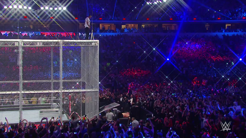 Shane McMahon jumps off the cell