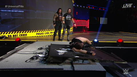 Seth Rollins and Roman Reigns put Kevin Owens through a different announce table
