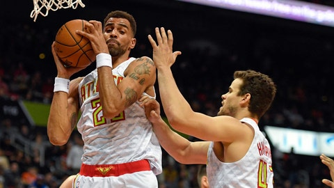 Dec 28, 2016; Atlanta, GA, USA; Atlanta Hawks forward Thabo Sefolosha (25) controls a rebound in front of forward Kris Humphries (43) against the New York Knicks during the first half at Philips Arena. Mandatory Credit: Dale Zanine-USA TODAY Sports