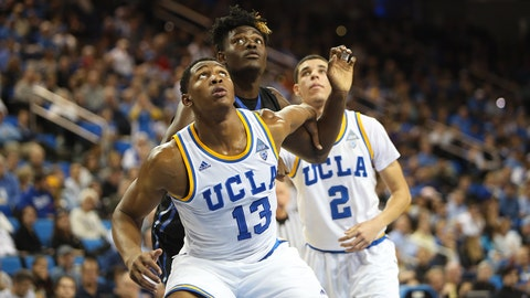 Ike Anigbogu fights for a rebound during Wednesday's action at Pauley Pavilion.
