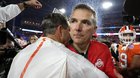 December 31, 2016; Glendale, AZ, USA; Ohio State Buckeyes head coach Urban Meyer meets witn Clemson Tigers head coach Dabo Swinney following the 31-0 loss in the the 2016 CFP semifinal at University of Phoenix Stadium. Mandatory Credit: Matthew Emmons-USA TODAY Sports