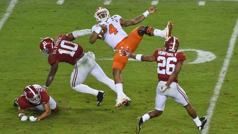 Jan 9, 2017; Tampa, FL, USA; Clemson Tigers quarterback Deshaun Watson (4) is hit by Alabama Crimson Tide linebacker Reuben Foster (10) during the third quarter in the 2017 College Football Playoff National Championship Game at Raymond James Stadium. Mandatory Credit: Jasen Vinlove-USA TODAY Sports