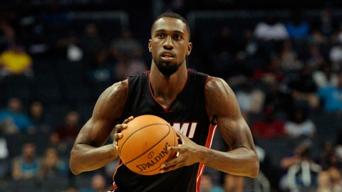 Heat keep Okaro White, part with Derrick Williams