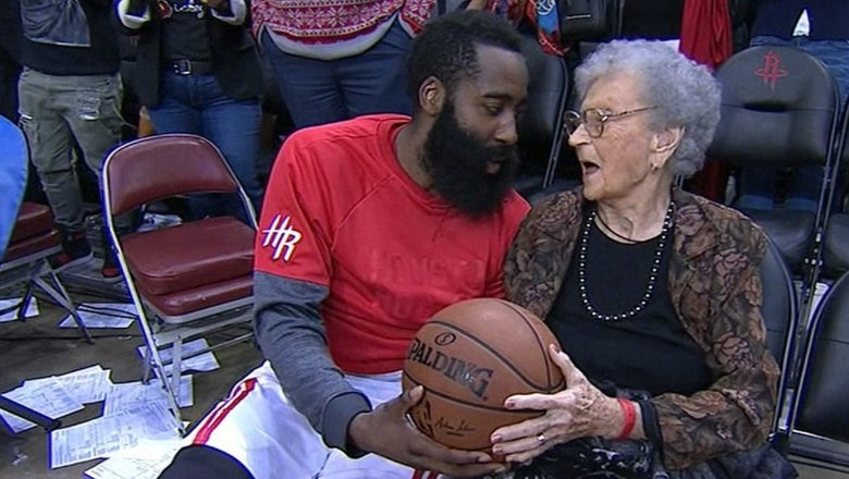 James Harden gives the game ball to a 100-year-old woman on her birthday