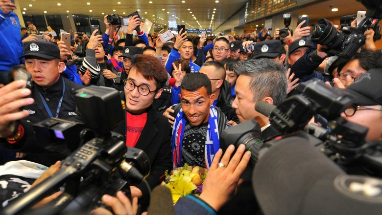 Carlos Tevez was greeted by an absolute mob upon his China arrival