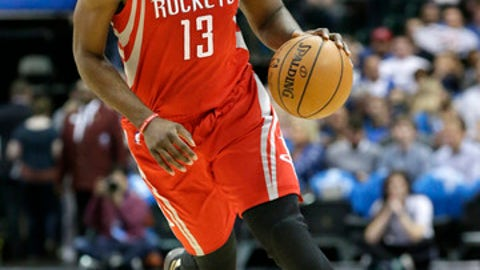 Houston Rockets guard James Harden (13) dribbles during the first half of an NBA basketball game against the Dallas Mavericks in Dallas, Tuesday, Dec. 27, 2016. (AP Photo/LM Otero)