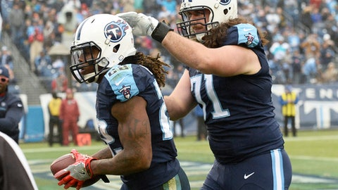 Tennessee Titans running back Derrick Henry (22) is congratulated by offensive tackle Dennis Kelly (71) after Henry scored a touchdown on a 2-yard run against the Houston Texans in the second half of an NFL football game Sunday, Jan. 1, 2017, in Nashville, Tenn. (AP Photo/Mark Zaleski)