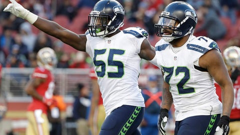 Seattle Seahawks defensive end Michael Bennett (72) celebrates with defensive end Frank Clark after sacking San Francisco 49ers quarterback Colin Kaepernick during the second half of an NFL football game in Santa Clara, Calif., Sunday, Jan. 1, 2017. (AP Photo/Marcio Jose Sanchez)