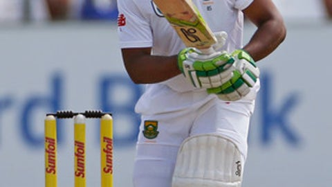 South Africa's Temba Bavuma plays a shot, during the 2nd Test cricket match between South Africa and Sri Lanka in Cape Town, South Africa, Monday, Jan. 2, 2017. (AP Photo/Schalk van Zuydam)