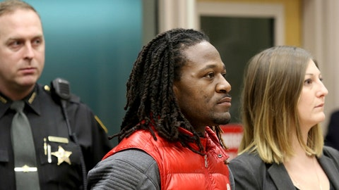 """Bengals cornerback Adam """"Pacman"""" Jones is arraigned Tuesday Jan. 3, 2017 in Hamilton County Municipal Court, in Cincinatti, after be charged with a felony charge of harassment with a bodily substance. He is also charged with assault, disorderly conduct and obstructing police. An attorney representing Jones has told a Hamilton County judge that he """"vehemently denies"""" the charges that led to his arrest. The judge set bonds totaling $37,500. /The Cincinnati Enquirer via AP)"""