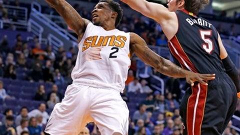 Phoenix Suns guard Eric Bledsoe (2) drives past Miami Heat forward Luke Babbitt (5) during the first half of an NBA basketball game Tuesday, Jan. 3, 2017, in Phoenix. (AP Photo/Ross D. Franklin)