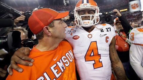 Clemson head coach Dabo Swinney talks to Deshaun Watson during the second half of the NCAA college football playoff championship game against Alabama Tuesday, Jan. 10, 2017, in Tampa, Fla. (AP Photo/David J. Phillip)