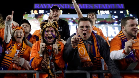 Clemson fans react after the NCAA college football playoff championship game against Alabama Tuesday, Jan. 10, 2017, in Tampa, Fla. Clemson won 35-31. (AP Photo/Chris O'Meara)