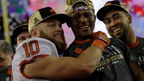 Clemson's Ben Boulware hugs Deshaun Watson after the NCAA college football playoff championship game against Alabama Tuesday, Jan. 10, 2017, in Tampa, Fla. Clemson won 35-31. (AP Photo/David J. Phillip)