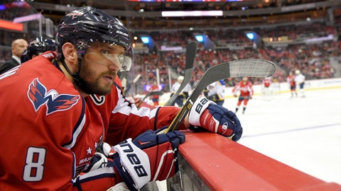 FILE- In this Nov. 23, 2016, file photo, Washington Capitals left wing Alex Ovechkin (8), of Russia, looks on from the bench during the third period of an NHL hockey game against the St. Louis Blues in Washington. Ovechkin is one point shy of his 1,000th NHL career point. He could hit the milestone Wednesday night, Jan. 11, 2017, against longtime rival Sidney Crosby and the Pittsburgh Penguins. (AP Photo/Nick Wass, File)
