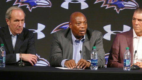 Baltimore Ravens general manager Ozzie Newsome, center, speaks as team president Dick Cass, left, and owner Steve Bisciotti listen during an NFL football news conference, Tuesday, Jan. 10, 2017, in Owings Mills, Md. (Kevin Richardson/The Baltimore Sun via AP)