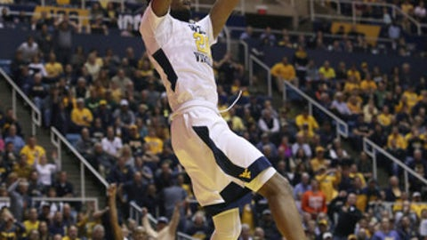 West Virginia forward Brandon Watkins (20) dunks the ball on a fast break during the second half of an NCAA college basketball game against Baylor, Tuesday, Jan. 10, 2017, in Morgantown, W.Va. (AP Photo/Raymond Thompson)