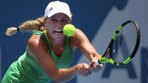 Caroline Wozniacki of Denmark plays a shot to Barbora Strycova of Czech Republic during their women's singles match at the Sydney International tennis tournament in Sydney, Australia, Wednesday, Jan. 11, 2017. (AP Photo/Rick Rycroft)