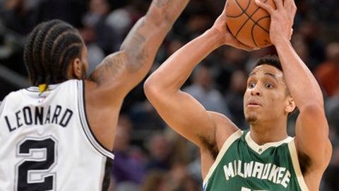 Milwaukee Bucks guard Malcolm Brogdon (13) shoots against San Antonio Spurs forward Kawhi Leonard during the first half of an NBA basketball game, Tuesday, Jan. 10, 2017, in San Antonio. (AP Photo/Darren Abate)