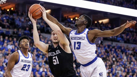 Butler's Nate Fowler (51) grabs a rebound between Creighton's Justin Patton (23) and Cole Huff (13) during the first half of an NCAA college basketball game in Omaha, Neb., Wednesday, Jan. 11, 2017. (AP Photo/Nati Harnik)