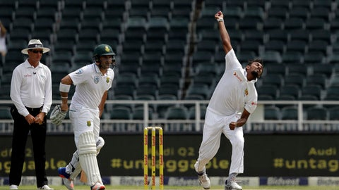 Sri Lanka's bowler Suranga Lakmal, right, bowls as South Africa's batsman Dean Elgar, center, and umpire Rod Tucker of Australia, watches during the first day of their third cricket test match at Wanderers stadium in Johannesburg, South Africa, Thursday, Jan. 12, 2017. (AP Photo/Themba Hadebe)