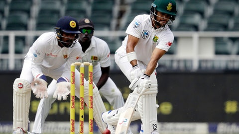 South Africa's batsman JP Duminy, right, plays a reverse shot as Sri Lanka's wicket keeper Dinesh Chandimal, left, watches during the first day of the third cricket test match between South Africa and Sri Lanka, at Wanderers stadium in Johannesburg, South Africa, Thursday, Jan. 12, 2017. (AP Photo/Themba Hadebe)