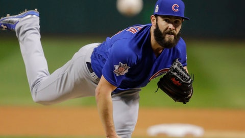FILE - In this Oct. 26, 2016, file photo, Chicago Cubs starting pitcher Jake Arrieta throws during the first inning of Game 2 of the Major League Baseball World Series against the Cleveland Indians, in Cleveland. Washington outfielder Bryce Harper, Cubs pitcher Jake Arrieta, New York Mets pitchers Matt Harvey and Jacob deGrom, and Baltimore third baseman Manny Machado were among 146 players eligible to exchange salary arbitration figures with their teams, though most were expected to reach agreements.(AP Photo/Gene J. Puskar, File)