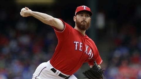 Texas Rangers closer Sam Dyson throws to the Toronto Blue Jays in the ninth inning of Game 2 of baseball's American League Division Series, Friday, Oct. 7, 2016, in Arlington, Texas. (AP Photo/LM Otero)
