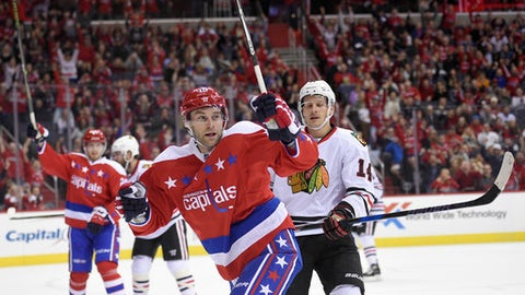 Washington Capitals right wing Brett Connolly (10) celebrates his goal in front of Chicago Blackhawks left wing Richard Panik (14), Slovakia, during the first period of an NHL hockey game, Friday, Jan. 13, 2017, in Washington. (AP Photo/Nick Wass)