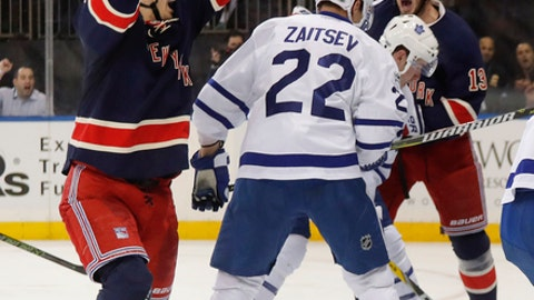 New York Rangers left wing Chris Kreider, left, reacts after scoring against the Toronto Maple Leafs during the second period of an NHL hockey game, Friday, Jan. 13, 2017, in New York. (AP Photo/Julie Jacobson)