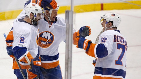 New York Islanders left wing Jason Chimera, center, and left wing Anthony Beauvillier (72) congratulate defenseman Nick Leddy (2) after Leddy scored a goal during the second period of an NHL hockey game against the Florida Panthers, Friday, Jan. 13, 2017, in Sunrise, Fla. (AP Photo/Wilfredo Lee)